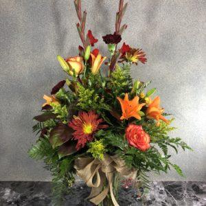 autumn flowers in glass vase